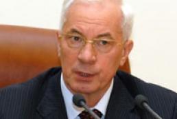 Azarov says ministers' allowance reduced three times