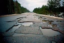 Weather hinders road repair