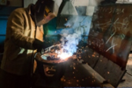 Real men onboard: rugged engineers and charming blacksmith
