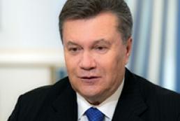Yanukovych signs EU law on elections