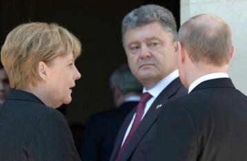 Порошенко обсудил с Меркель, Олландом и Путиным реализацию мирного плана на Донбассе