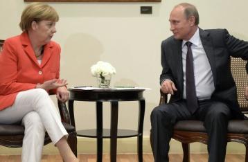 Путин и Меркель за возобновление переговоров по Украине в формате видеоконференции