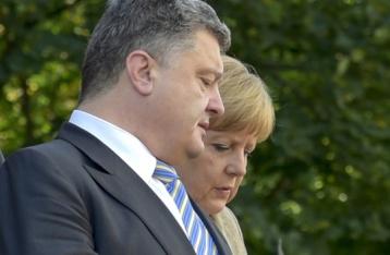 Порошенко и Меркель обеспокоены нарушением перемирия на Донбассе