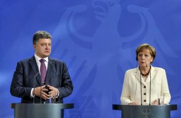 Порошенко и Меркель договорились обсудить  сегодня ситуацию на Донбассе