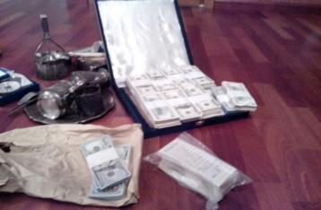 Военный прокурор опубликовал фото с обыска дома николаевского чиновника