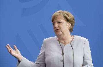 Меркель не видит условий для проведения выборов на Донбассе