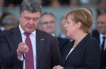 Порошенко и Меркель договорились о встрече глав МИД «нормандской четверки» в конце ноября