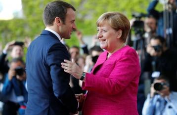 Меркель и Макрон требуют немедленного прекращения огня на Донбассе